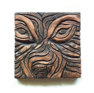 WOLF TILE $75, terra cotta clay, 14cm x 14cm - This dimensional tile was sculpted using relief techniques and stained with shoe polish. The textures tell their own story!